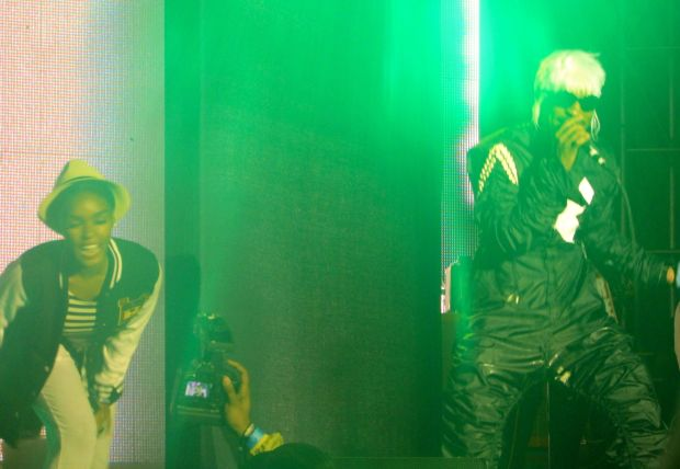 "Janelle Monae on stage with Andre 3000 during his performance of ""Hey Ya"""